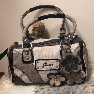 Floral and snakeskin Guess purse